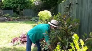 Juliet working in Kate's garden