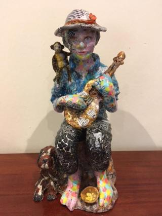 Sculpture young guitarist